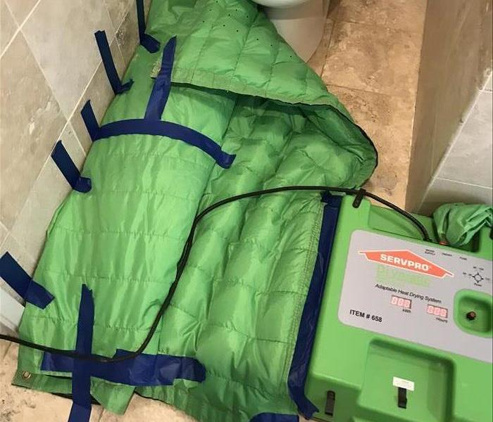 green quilted drying system in bathroom