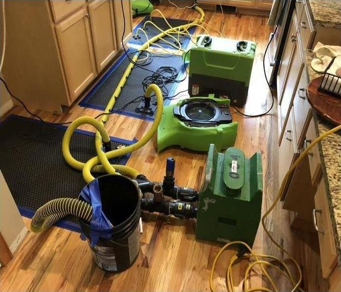 Our water extraction equipment drying the hardwoods in the kitchen of this room